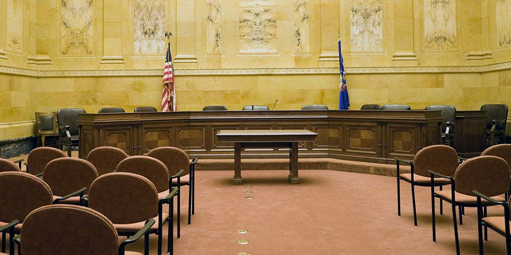 Landscape image of an empty courtroom, which is not being used due to coronavirus