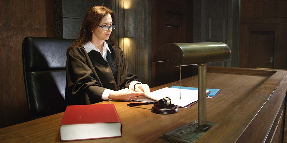 A female judge prepares for her remote court hearing in Los Angeles