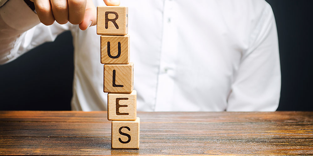 Blocks spell out the word 'rules' in this concept photo for the amendments to Rule 30(b)(6)