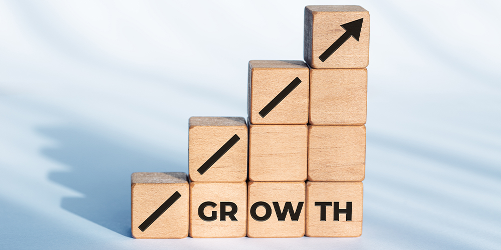 Concept photo of a staircase of wooden blocks with the word 'growth' written on the side - illustrating the professional growth of a court reporter.